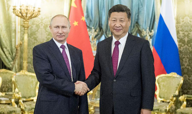 China, Russia pledge to play role of ballast stone for world peace
