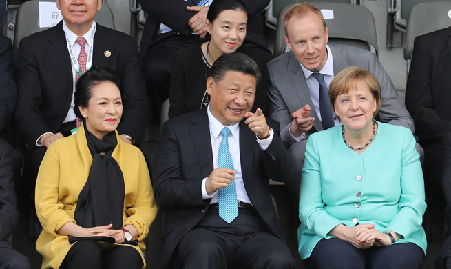 Xi, Merkel watch friendly football match between Chinese, German youth teams