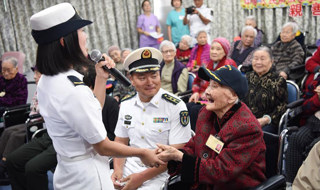 Soldiers, officers of aircraft carrier Liaoning visit elders in HK