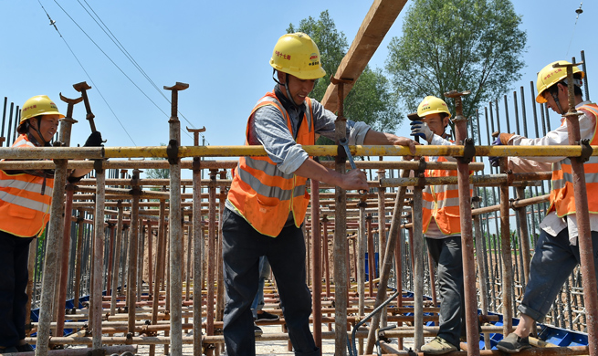 Builders work at construction site in hot summer in N China