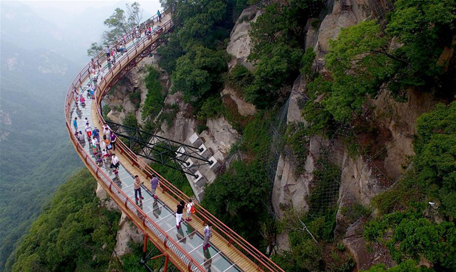 Scenery of plank road on cliff of Shaohua Mountain in NW China