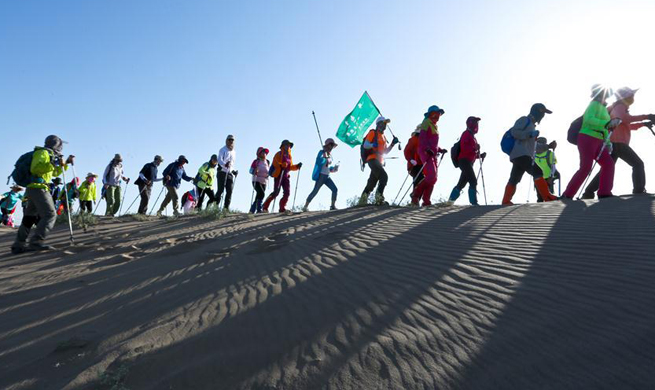 10 kilometer desert hiking challenge competition held in Zhangye, NW China