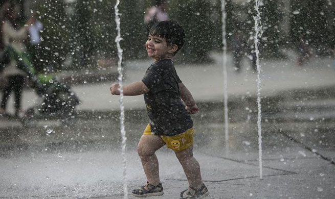 People cool off themselves as heat wave hits Tehran, Iran