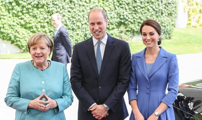 Merkel meets Prince William and his wife in Berlin
