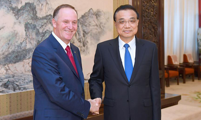 Premier Li says China to open wider to world
