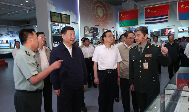 Top Chinese leaders visit military exhibition