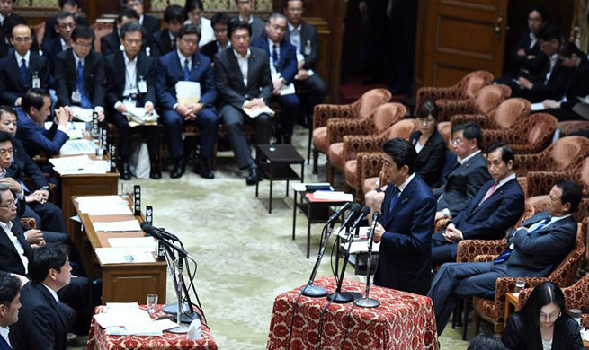 Japan's Abe grilled on cronyism, defense chief's cover-up scandal amid plummeting support rate