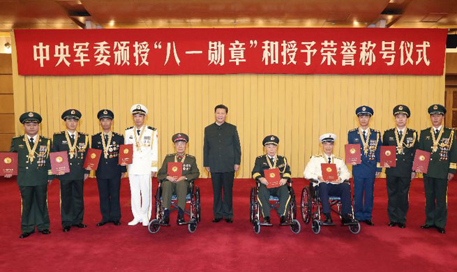 Xi honors military officers, unit ahead of Army Day