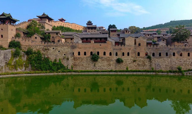 Old castle attracts tourists in China's Shanxi