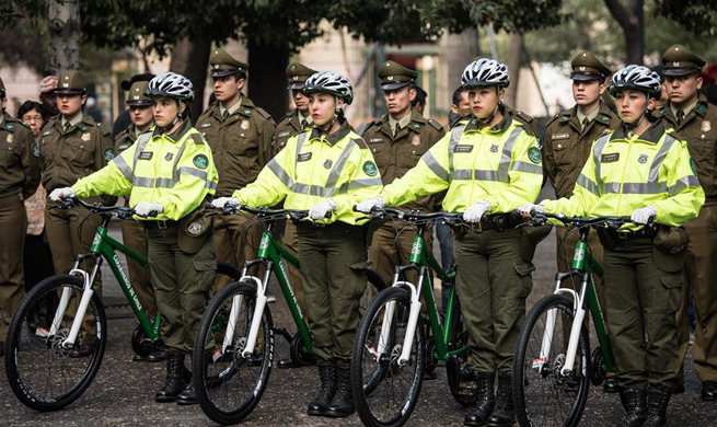 China donates bicycles for local police patrols in Santiago, Chile