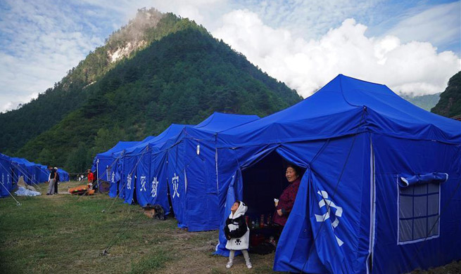 Quake-affected people start lives in tents in China's Sichuan