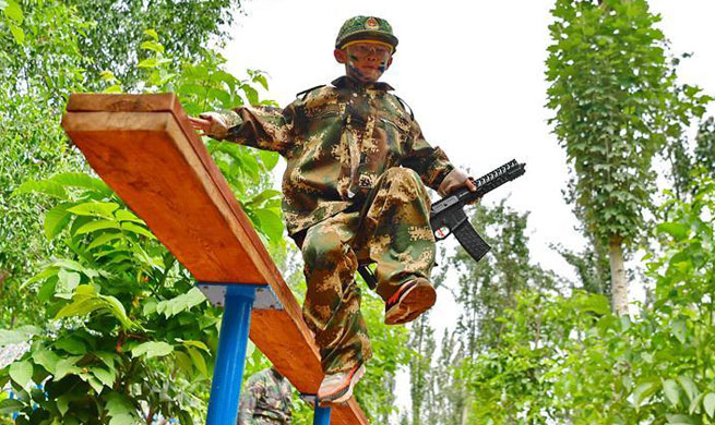 Children attend military summer camp in N China