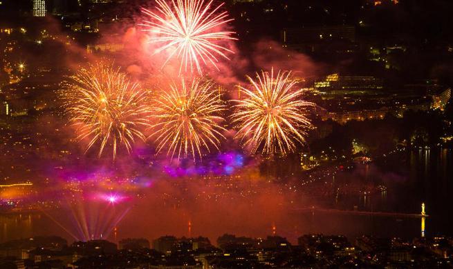 Fireworks illuminate sky over Leman Lake during Geneva Festival in Switzerland