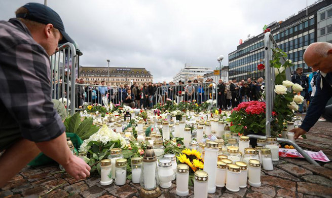 People commemorate victims of knife attack in Finland