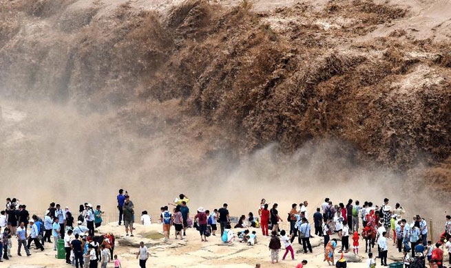 Water volume of Hukou Waterfall surged due to heavy rainfall