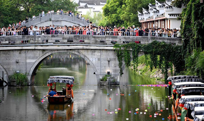 E China holds river lantern festival to greet upcoming Qixi festival
