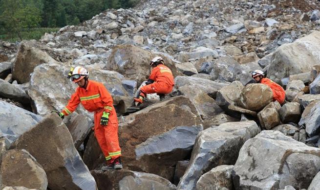 Two dead, 25 missing after landslide in southwest China