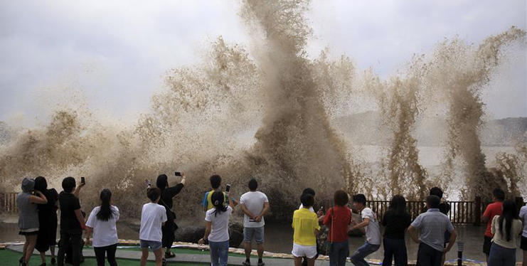 Super typhoon Talim brings gale and heavy rainfall, causing billows in E China