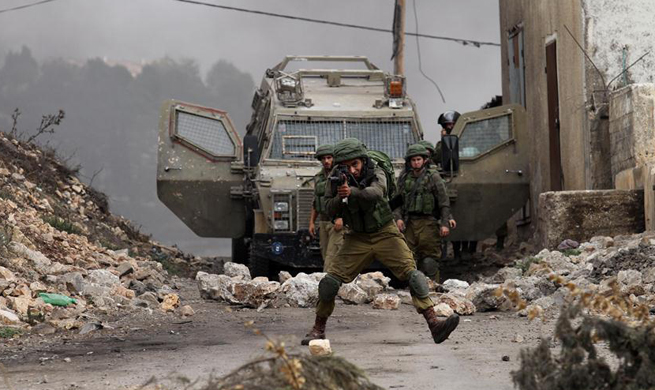 Israeli soldiers clash with Palestinian protesters in Nablus