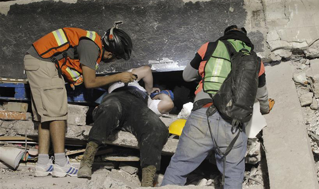 Rescue teams work to find survivors as Mexico quake toll reaches 230