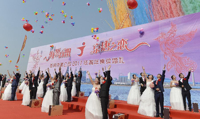 21 pairs of newlyweds attend group wedding ceremony in N China's Hebei