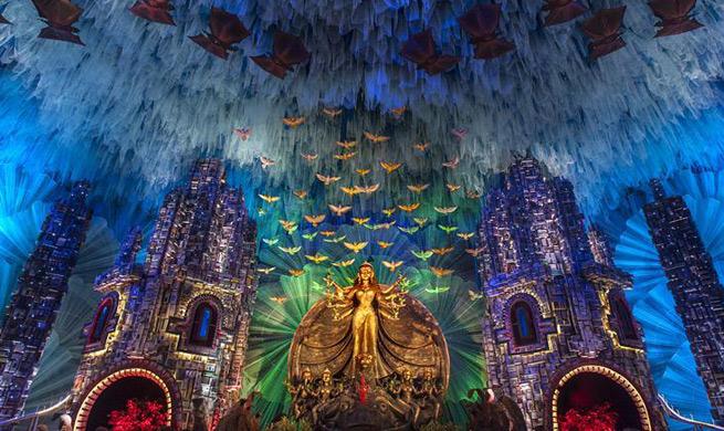 People prepare for Durga Puja festival in India