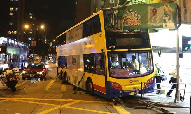 Three killed, 27 injured as bus mounts pavement in Hong Kong