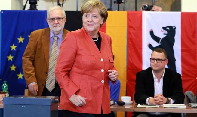 Merkel's conservative bloc garners 32.5 pct of vote