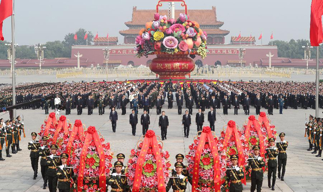 China's Xi pays tribute to national heroes at Tian'anmen Square