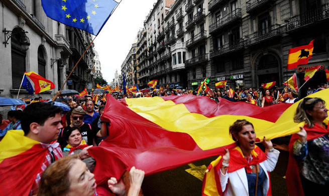 People take to street in Barcelona to defend Spain's unity