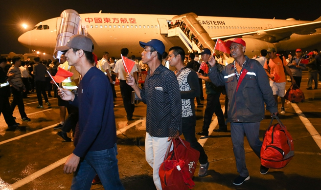Chartered flights bring home nearly 400 Chinese stranded by Hurricane Maria