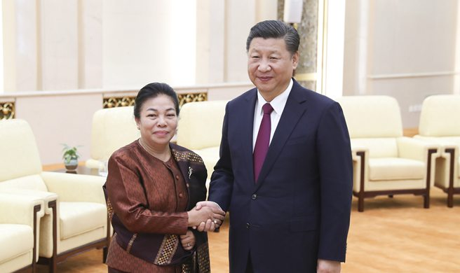 Ruling parties of China, Laos pledge further cooperation for closer bilateral ties
