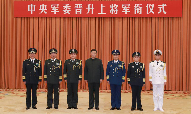China promotes military anti-graft chief to general