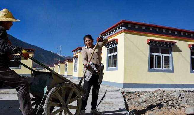 Impoverished villagers in China's Tibet move into new houses