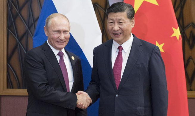 Xi, Putin pledge to enhance regional, int'l cooperation