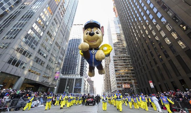 Feature: NYC's Thanksgiving Parade moves smoothly with giant balloons, heavy security