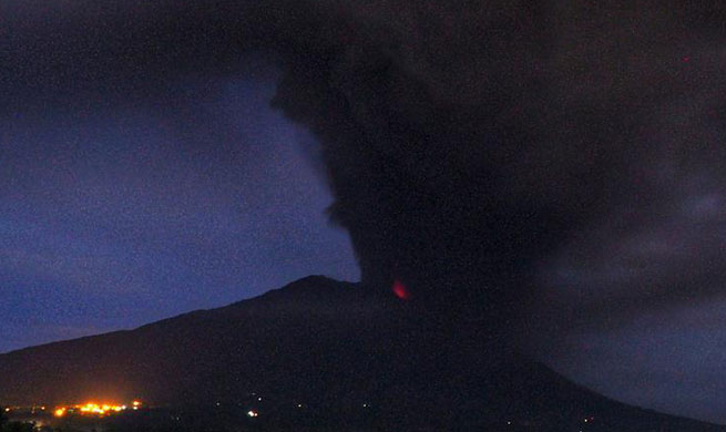 Mount Agung volcano spews ash in Indonesia