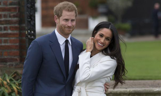 Britain's Prince Harry engages with American actress Meghan Markle