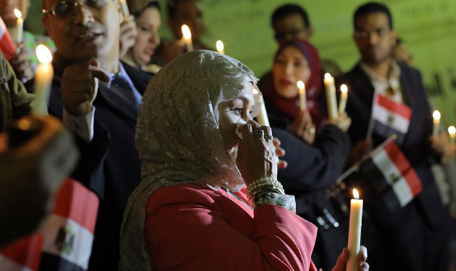 People attend memorial to mourn victims of North Sinai mosque attack