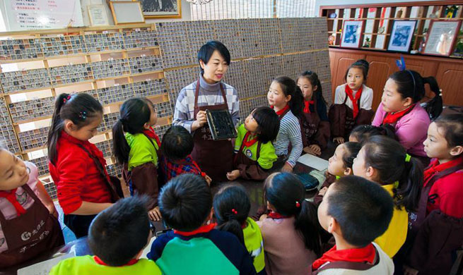 Pupils learn movable-type printing in China's Inner Mongolia