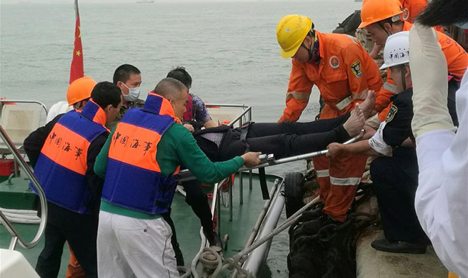 7 rescued, 5 still trapped in south China shipwreck