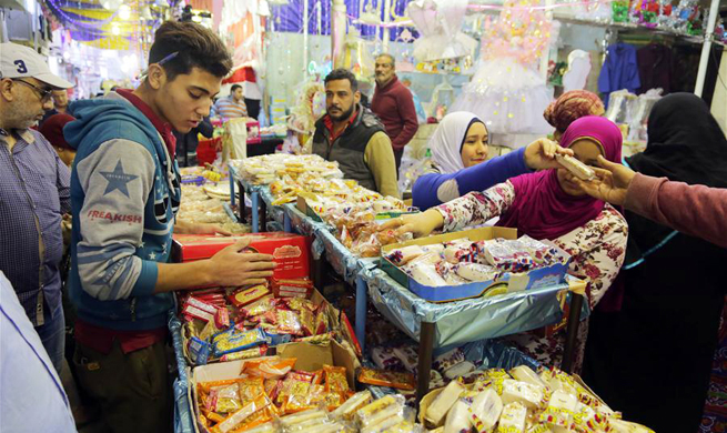 Egyptian Muslims mark birthday of Islam's Prophet Muhammad with special candies