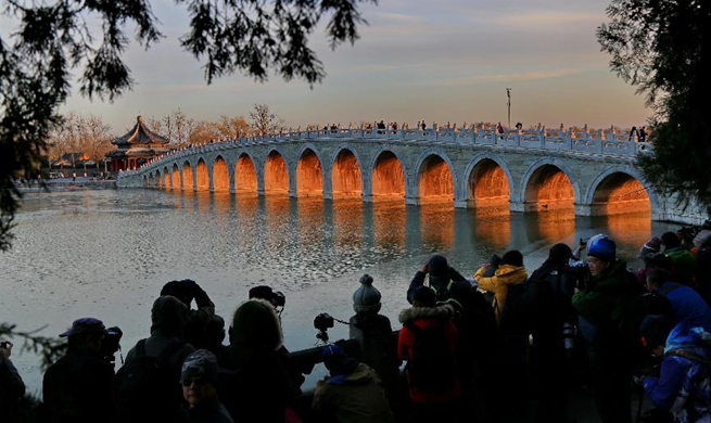 Twilight scenery through Seventeen Arch Bridge in Beijing's Summer Palace