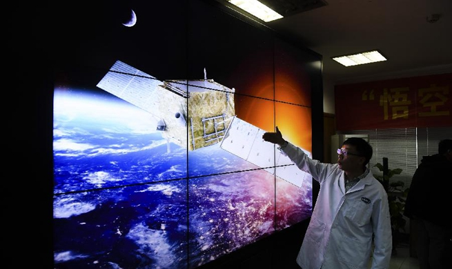 Pic story: Scientists dedicated to China's dark matter detection satellite