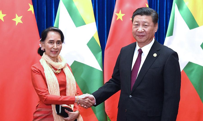 Xi meets Aung San Suu Kyi, calls for more party-to-party cooperation