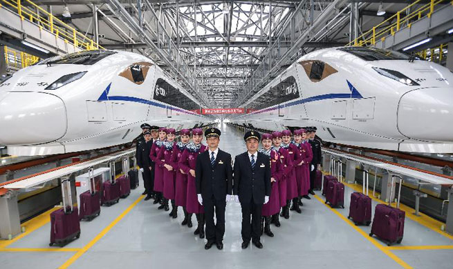 Crew members of high-speed trains linking Xi'an, Chengdu