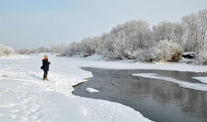 Cold fronts bring snowfall in N China