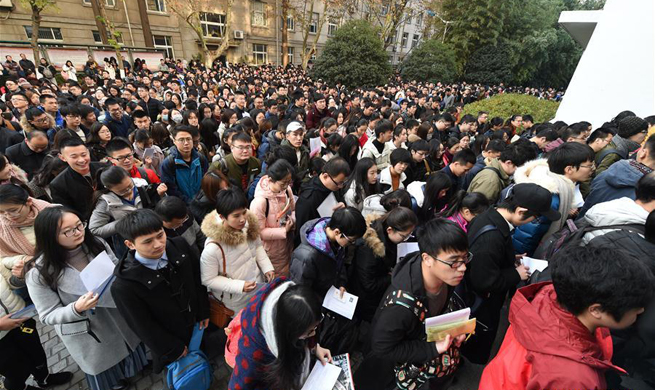 Over 1.1 mln people sit China's civil servant exam