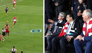 Li, Turnbull watch Australian Football match