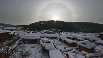 Solar halo appears over snow-covered scenic spot in NE China